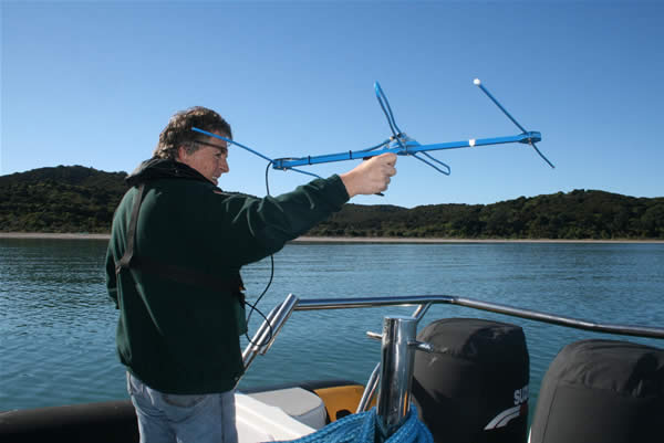 Direction-finding - Mike Lee monitoring bellbirds from the sea off Whakanewha Regional Park