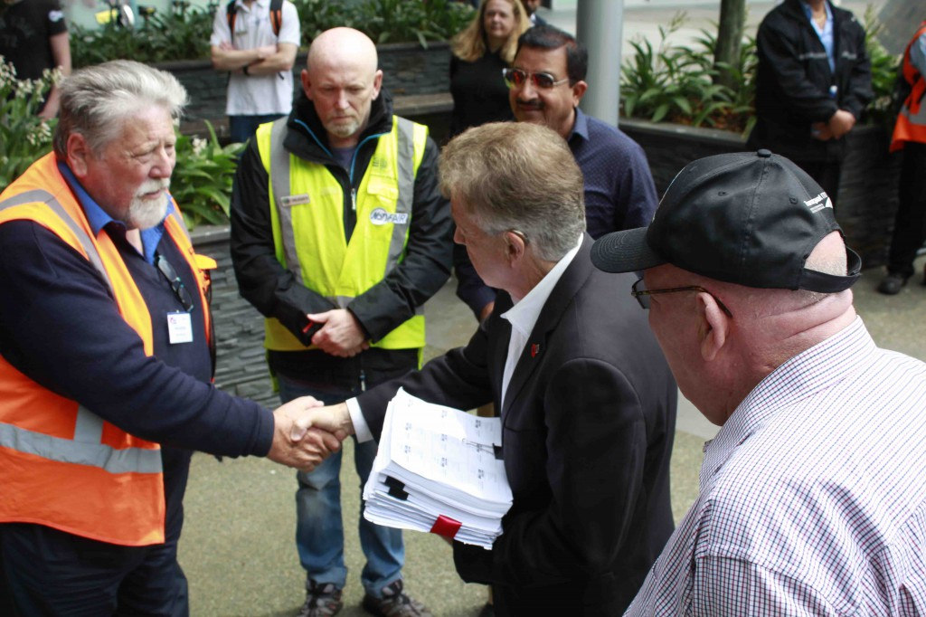 Receiving petitions outside AT head office from RMTU's Andrew Ward. From left Andrew,  Phil Morgan First Union, ML, Manoj  ? & Gary Froggatt Tramways Union. (Photo Jared Abbott)